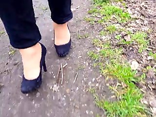 Outdoor session with two pairs of black heels