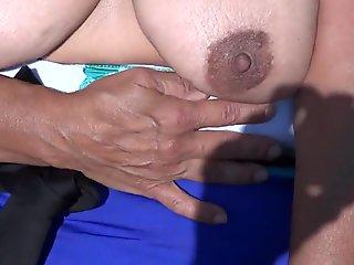 sun tanning my big tits