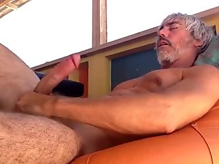 Silver Muscle Daddy On Orange Bean Bag Chair