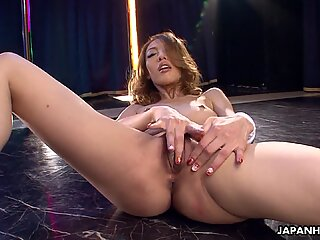 Asian stripper getting wild on the pole as she mas