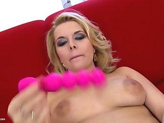 Lovely MILF feeding her pink pussy
