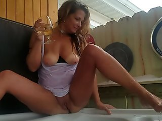 Mature Daizy Layne Posing and Playing with herself in Hot Tub