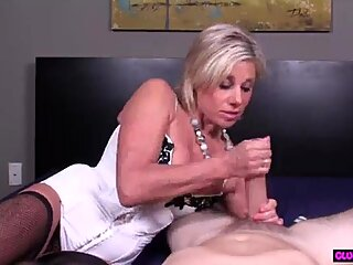 Mature beauty tugging dick in stockings - RealMilfDates.com